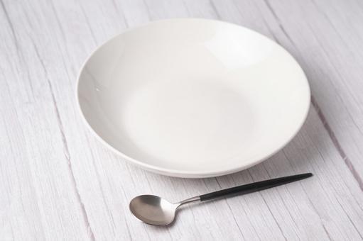 White plate white table spoon