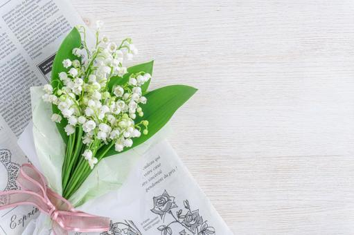 Lily of the valley bouquet and French wrapping paper