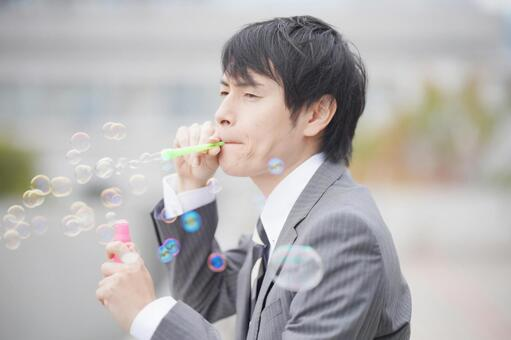 A man playing soap bubbles