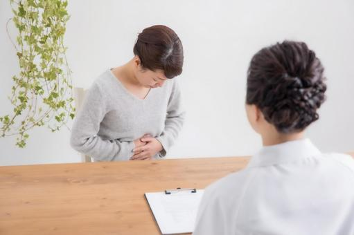 Counseling woman with stomachache