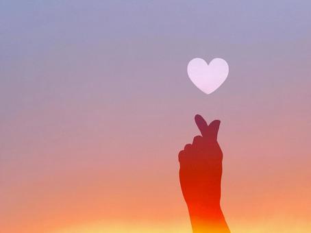 Kyun's hand silhouette sunset background