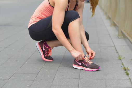 Female 4 connecting shoelaces