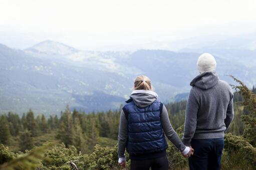 A couple standing in a nice view 7