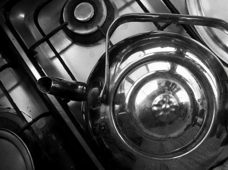 Kettle on black and white gas stove