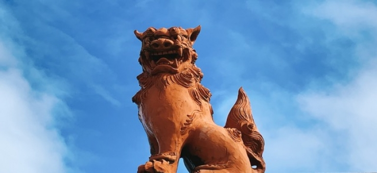 Shisa standing in the blue sky of Okinawa