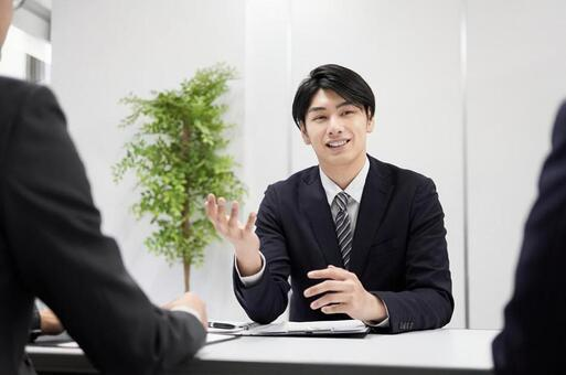 Japanese male businessman explaining face-to-face