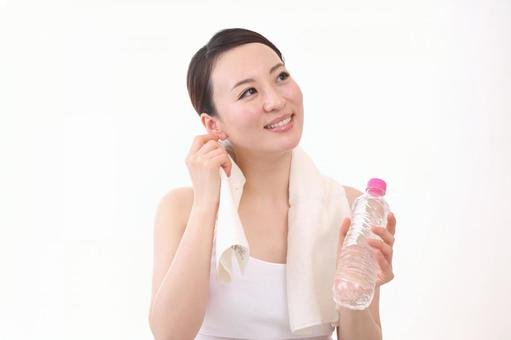 A woman with a plastic bottle 11