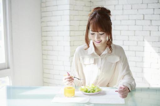 A woman taking breakfast 13
