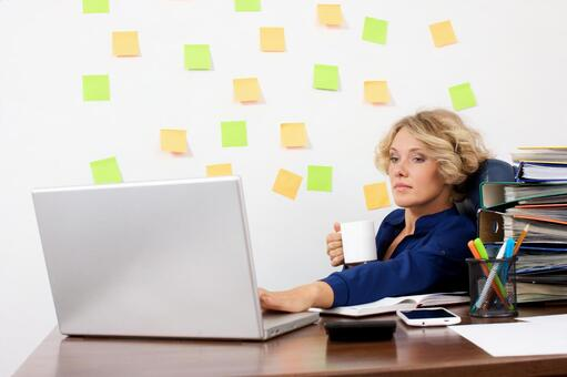 Working mother working at the desk in front of the wall with many sticky notes 14