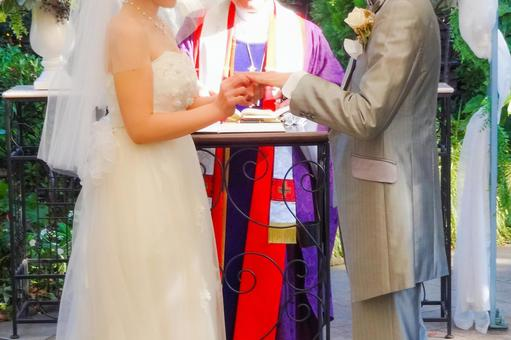 Ring exchange in front of the priest