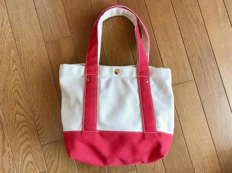 Red and white canvas tote bag