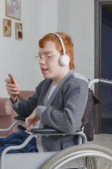 Boy operating a smartphone