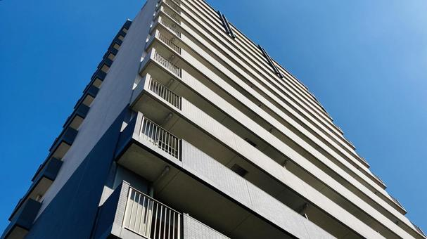 Condominium and blue sky real estate image