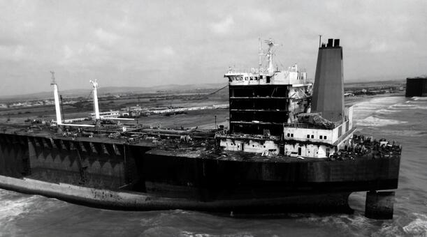 Tanker running in the black and white sea