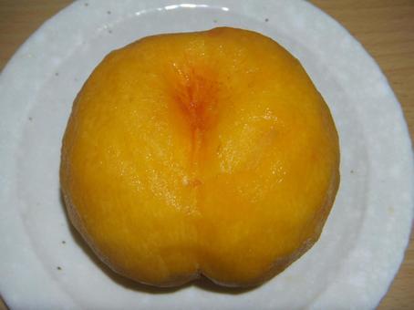 Peeled yellow peach white plate
