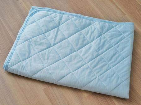 Folded light blue pad