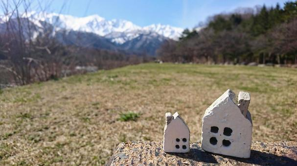 Snow mountain and grass and 2 small household items