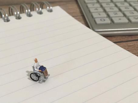 Elderly people in wheelchairs, calculators and notebooks