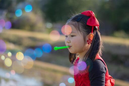 Girl playing soap bubbles
