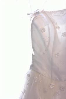 A wedding dress hanging on a hanger 5