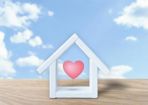 Home and heart sky background