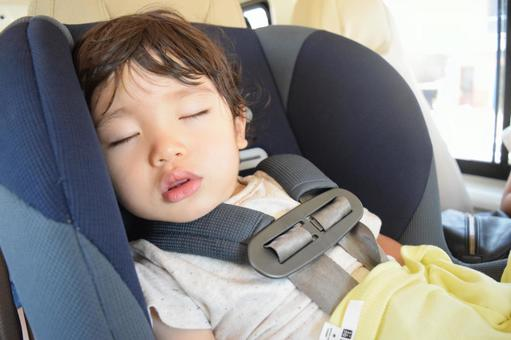Child sleeping with a child seat