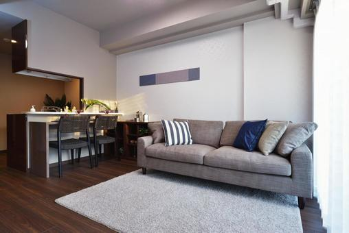 Modern living-dining room with sofa and counter table