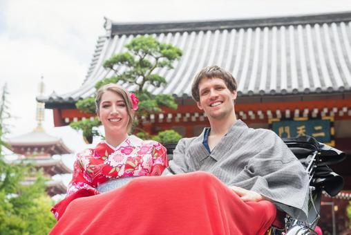 Foreign tourist couple 9 in Yukata riding a rickshaw
