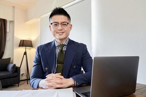 Asian male businessman having a remote meeting